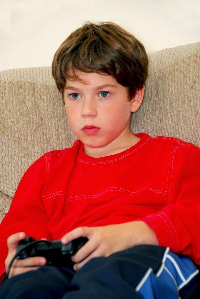 bigstock-Boy-Video-Game-910903-402x600